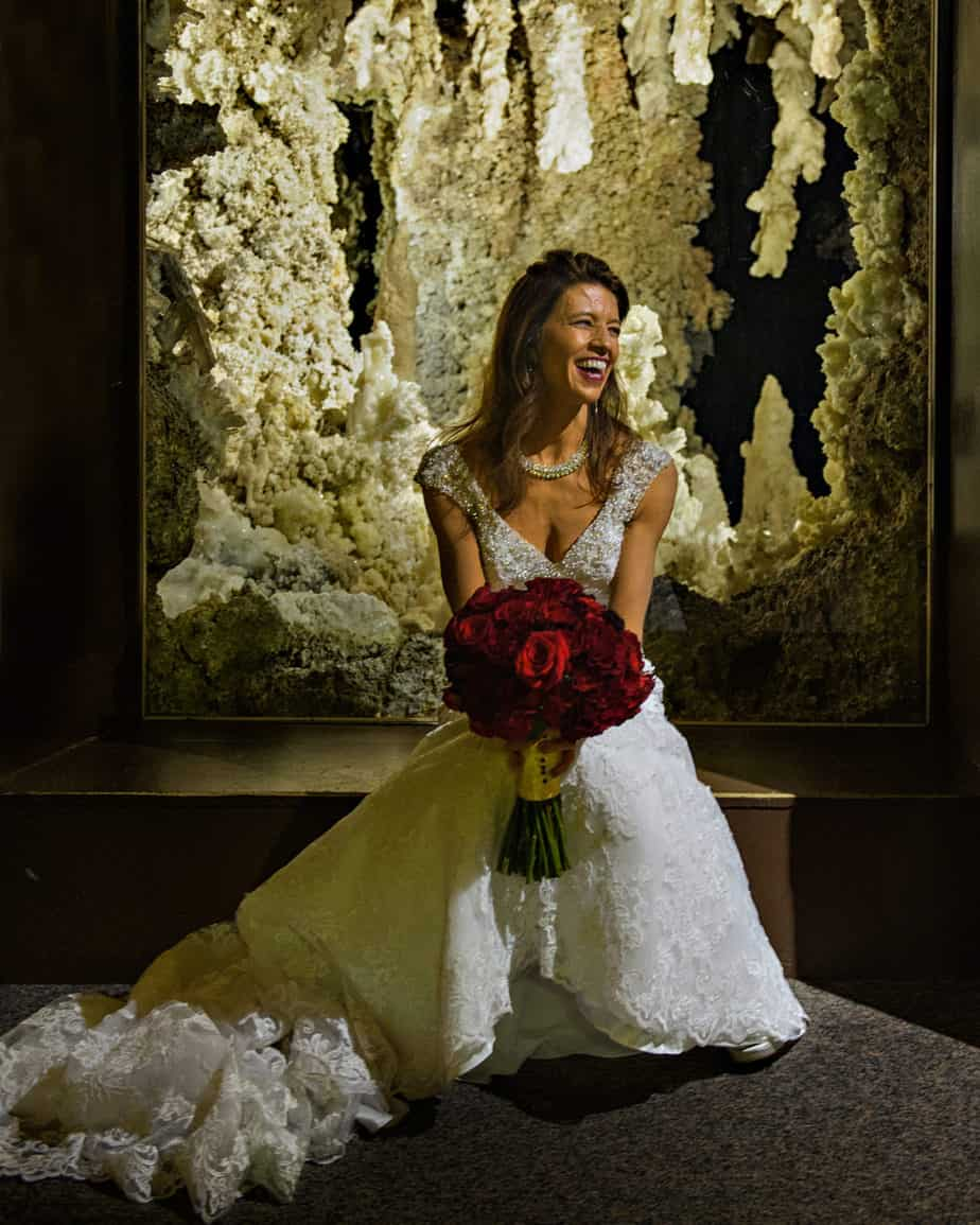red bridal bouquet_museum of nature and science wedding_cloud 9