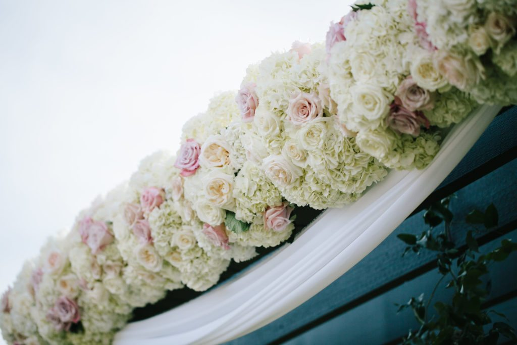 blush and white ceremony arch